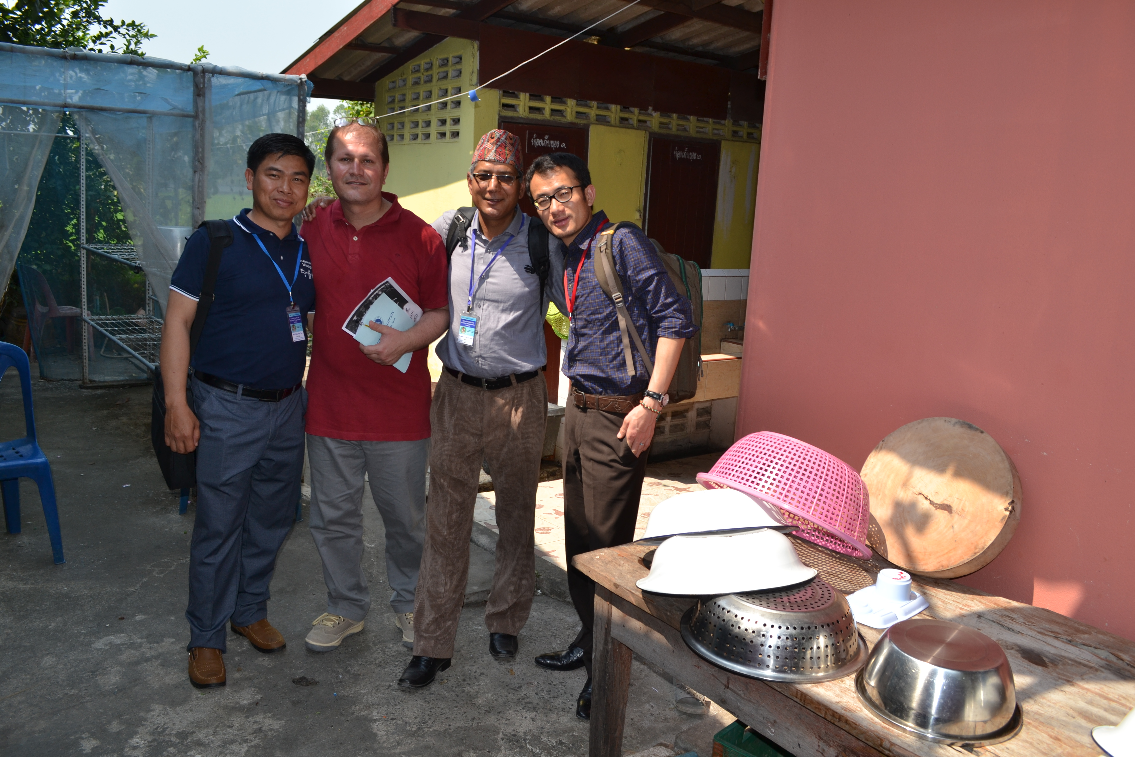 Bhutan's Sangay Thinley (R) on a school visit with colleagues from Nepal, Pakistan and Cambodia