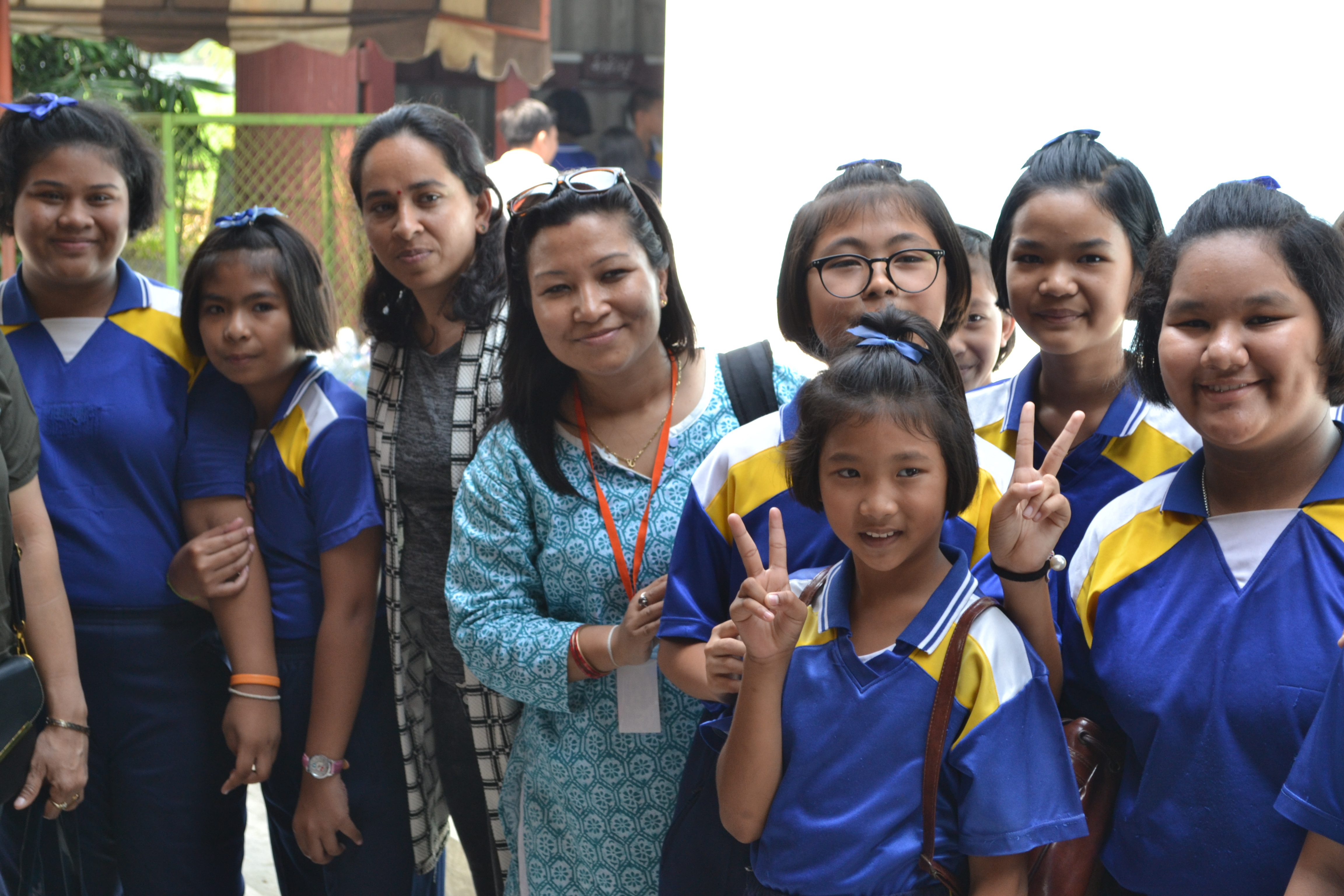 Nepal's Sajanmi Boyracharaya (c) with Thai pupils during school