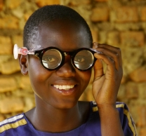 Child in Africa with refractive classes.jpg