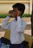 Boy having eyes testing in Cambodia.jpg