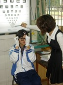 Chinese girl having eyes tested