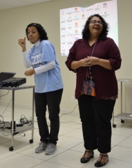 Inclusive Education in a school in Brazil: lady carries out sign language in classroom