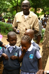 Kenyan school children taking deworming pills on a school-based deworming day