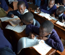 Schoolchildren reading textbooks in Kenya