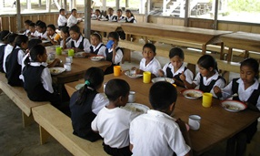 school children eating in a school canteen in Guyana